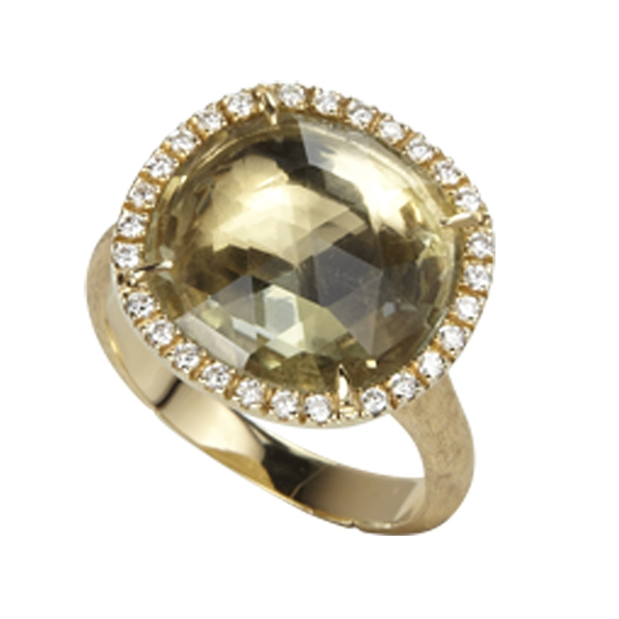 This 18kt yellow gold and gemstone ring from the Marco Bicego Jaipur collection is hot and cool, thanks to its components: a green amethyst surrounded by a halo of white diamonds sitting atop a warm, brushed precious metal band. The rose-cut cushion-shaped center stone has light-capturing facets. It's a Marco Bicego ring that is destined to capture attention and a lot of compliments, too!