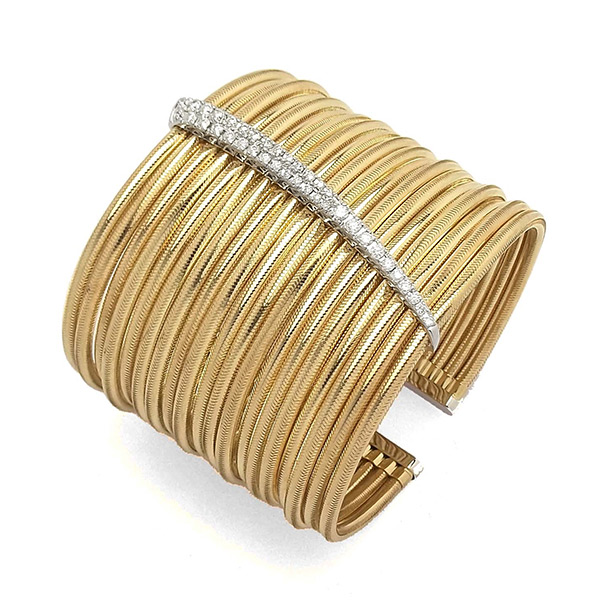 With all the glamour of Italy, this Ponte Vecchio Gioielli cuff bracelet is part of the Nobile collection. Nineteen stacked rows of flexible 18K yellow gold coils are capped with 18K white gold for a delicious two-toned style, and a decorative station of 18K white gold with white diamonds is placed at the center of this unforgettable piece. If you need a bracelet that absolutely stops traffic, then try this amazing Ponte Vecchio Gioielli cuff.