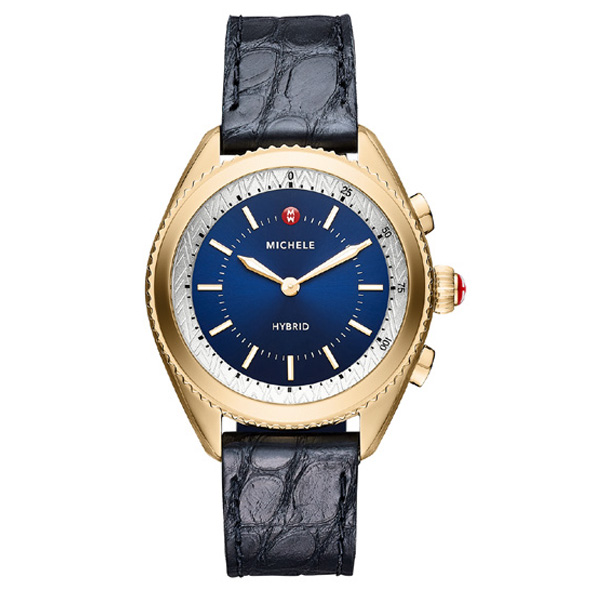 Make every moment count with a Michele Connected smartwatch! This yellow gold-tone plated model presents a navy sunray dial with luminous hands and markers that make it easy-to-read. Additional features include fitness tracking, alerts vibration, notifications, and a customizable function button that lets you take a photo or manage your music. It comes with a navy alligator strap backed with silicone for softness. Powered by a coin cell battery, a Michele app connects to your mobile phone to give you even more features. This beautiful Michele Connected will work for you! J.R. Dunn Jewelers has a 10-day satisfaction guarantee for all Michele watch products.