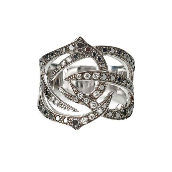 Stephen Webster's Thorn collection presents elegant jewelry under nefarious pretenses. Forged in 18K white gold, the wide band ring splits into thorny branches that are embellished with black and white diamonds to encase your finger beautifully. Your inner evil queen peeks out whenever you wear this amazing Stephen Webster ring.