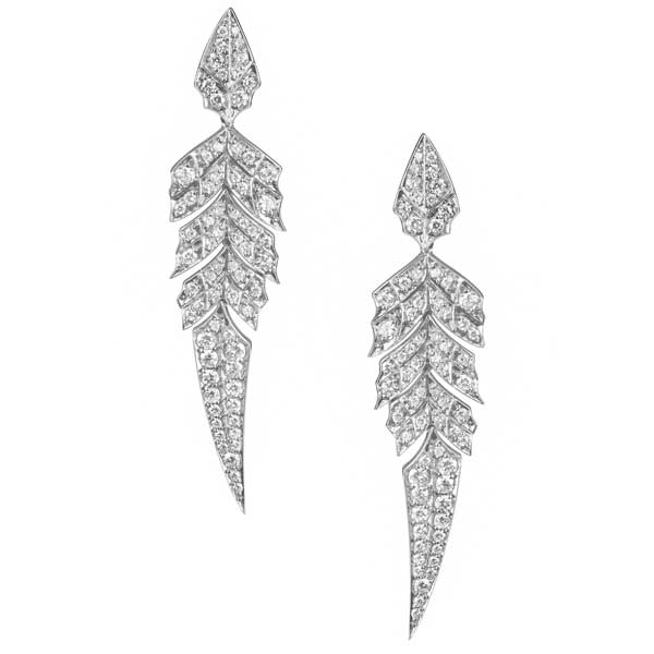With these Stephen Webster earrings from the Magnipheasant collection, you have every right to preen like a peacock. Each drop earring is fashioned like a feather and decadently embellished with luscious white diamonds. Let this set of earrings from Stephen Webster make you the glittering prize.
