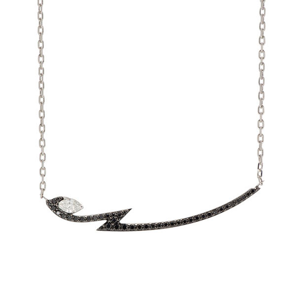 The Lady Stardust collection by Stephen Webster is bound to dazzle with this electrifying necklace. A lightening bolt of 18K white gold is adorned with scintillating black diamonds, and a white diamond with a marquise cut is housed in one of the zig zags for a unique look. If you want a little glamour in your style, try this Stephen Webster necklace.